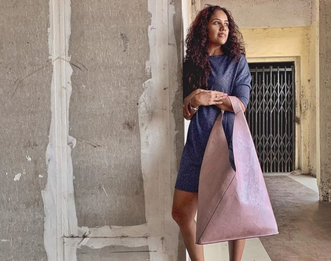 Founder holding oversized tote bag made of cork